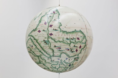 "Sam Durant's ""Antipodean Globe (Desliens 1566)"" Custom globe (acrylic, paper), steel cable, miscellaneous hardware 32 inches diameter (81.3 centimeters) Research and Cartography: Candice Lin, Nikki Pressley Source: H. Delachaux; The World: Copied directly at the Biblioteque Nationale, Paris, from the original [Nicholas Desliens 1566]; Year 1884 or 1898; Bib ID: 547024, Courtesy of the National Library of Australia"