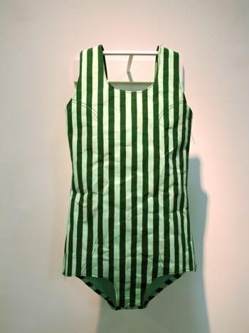 "Phranc Green Striped Swimsuit 2011 Kraft paper , tempura, gouache and thread 26 x 14 x 3"""