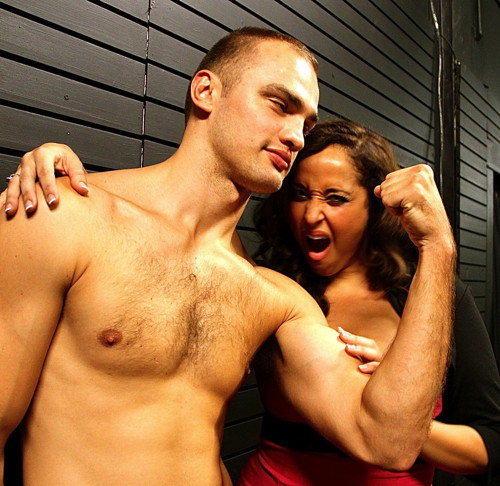 (l to r) Maria Russell (Blanca) admires Robert Jekabson's (Vladimir's) muscles - Photo by Josefina Lopez.
