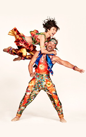 Rika Okamoto in the air clinging to Matthew Dibble's neck in Yowzie costumes. (Ruven Afanador / Twyla Tharp Dance Company)