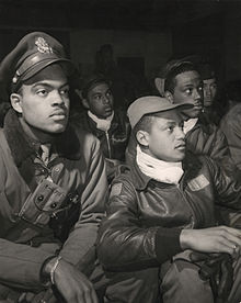Men of the 332nd Fighter Tuskegee Airmen. Members of the group attend a briefing in Italy in 1945.