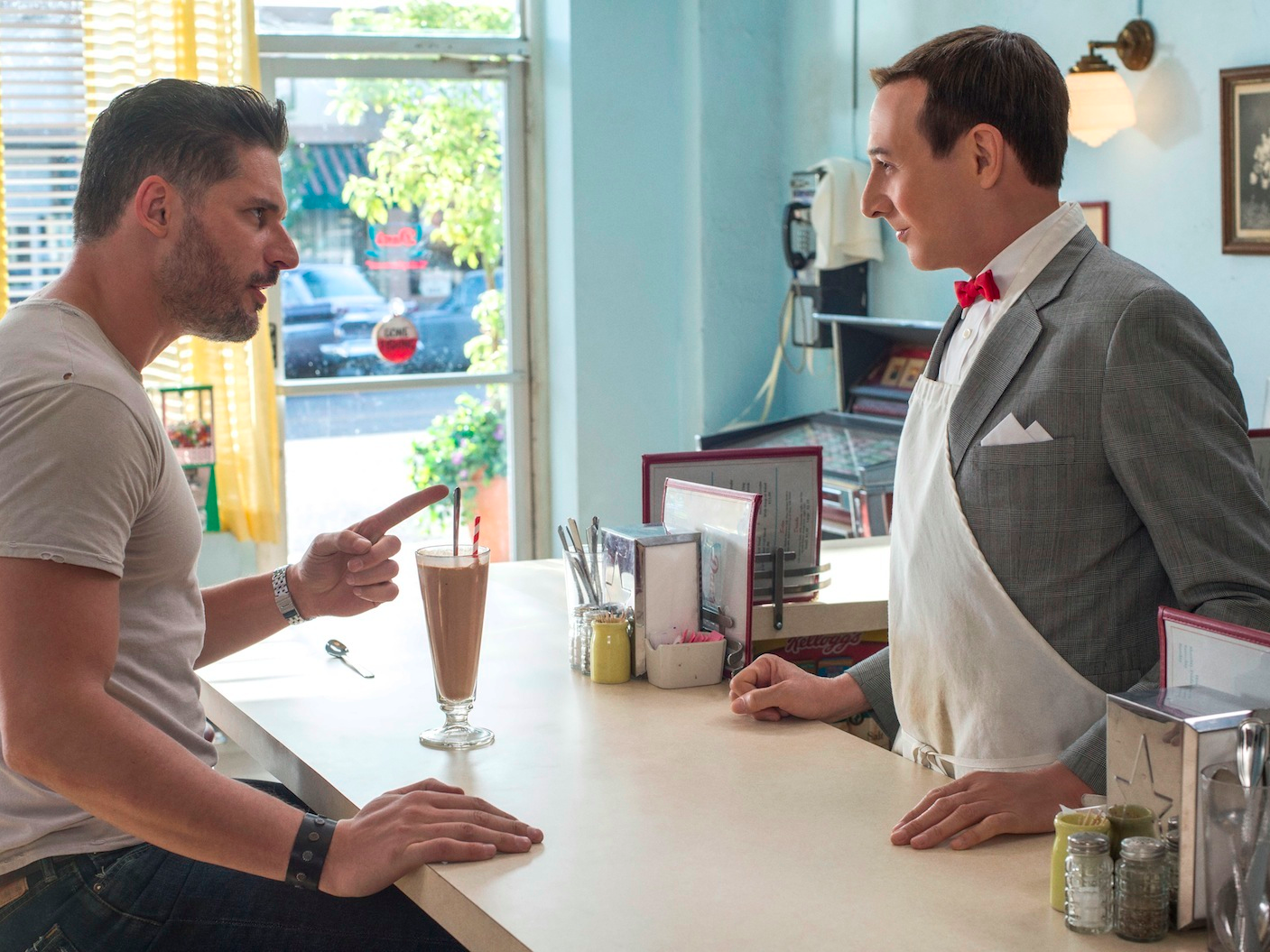 "Joe Mangianello and Paul Reubens in a scene from ""Pee-wee's Big Holiday."""